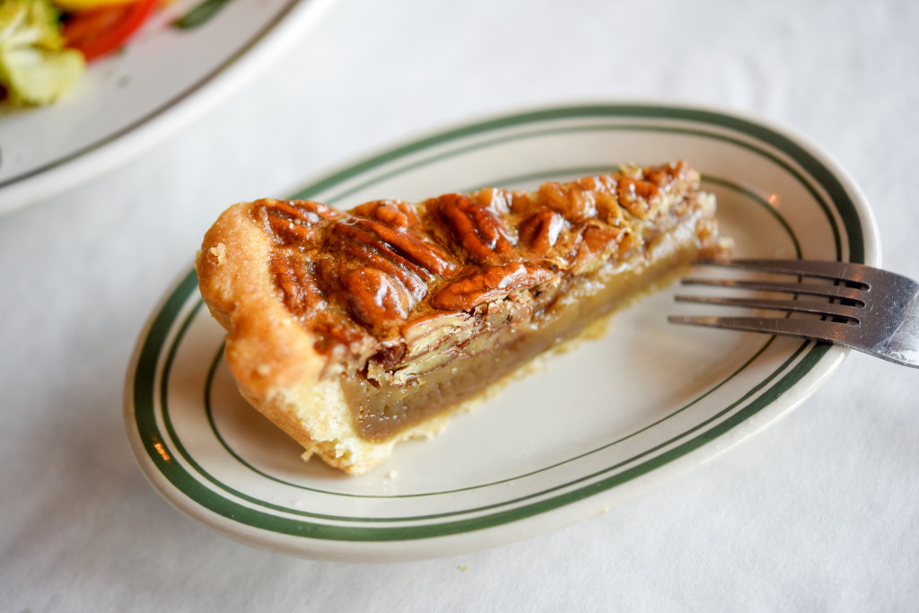 A traditional bourbon pecan pie with a flaky homemade crust.