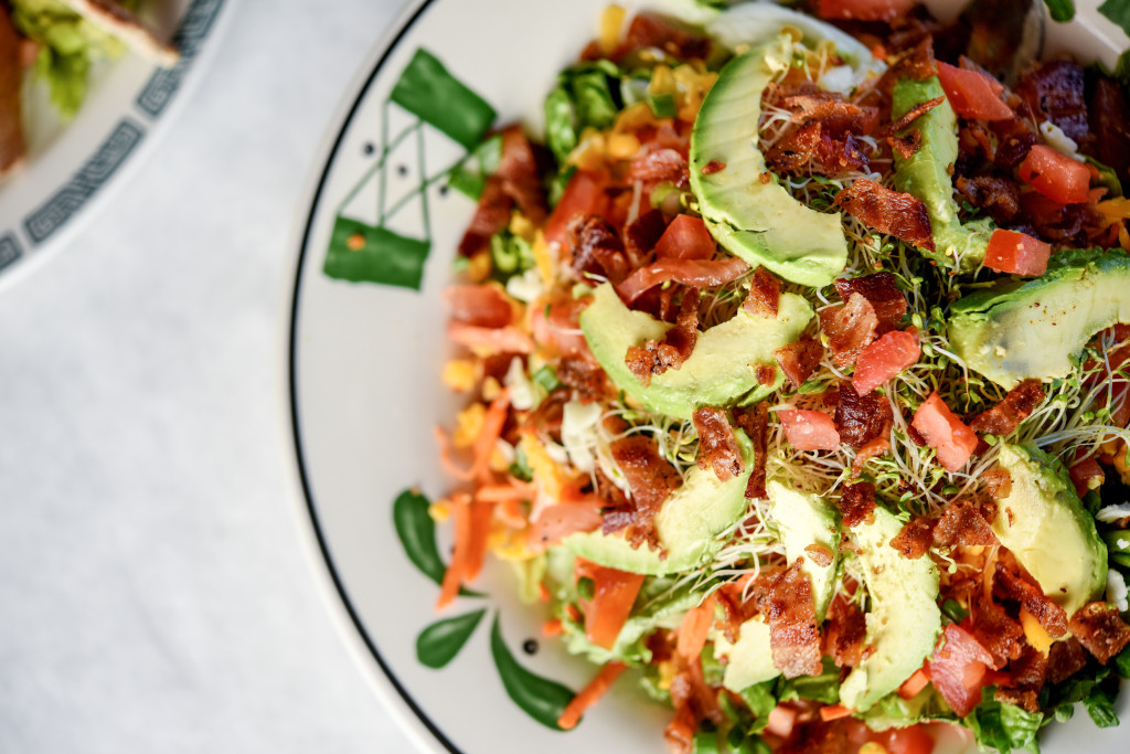 The hefty Magnolia House Salad with avocado, bacon, carrots, sprouts and more.