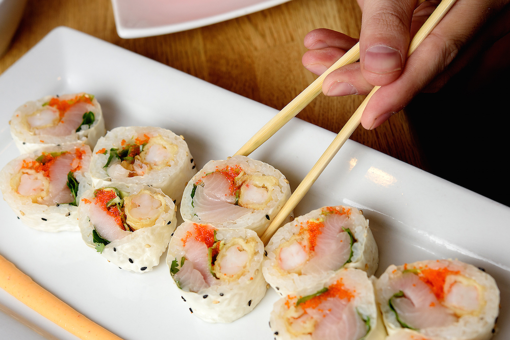 One of the expertly crafted sushi rolls wrapped in rice paper.