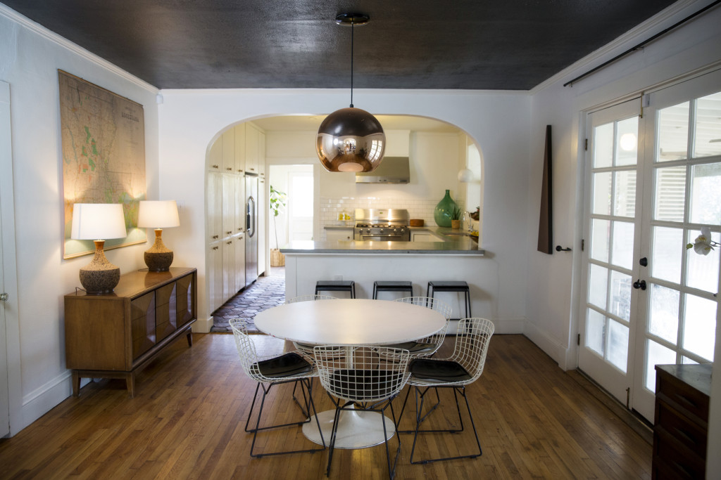 With the open floor plan, the Ellises can watch their kids playing in the living room while they cook. The dining table, found for Ellis by one of her friends, keeps with the home's clean look, while the copper pendant light adds warmth.
