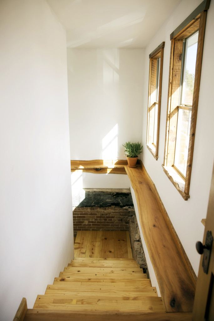 Even the stairs leading to the two-bedroom apartment were crafted by Moran. For this project, he used lumber from a neighbor's fallen tree.