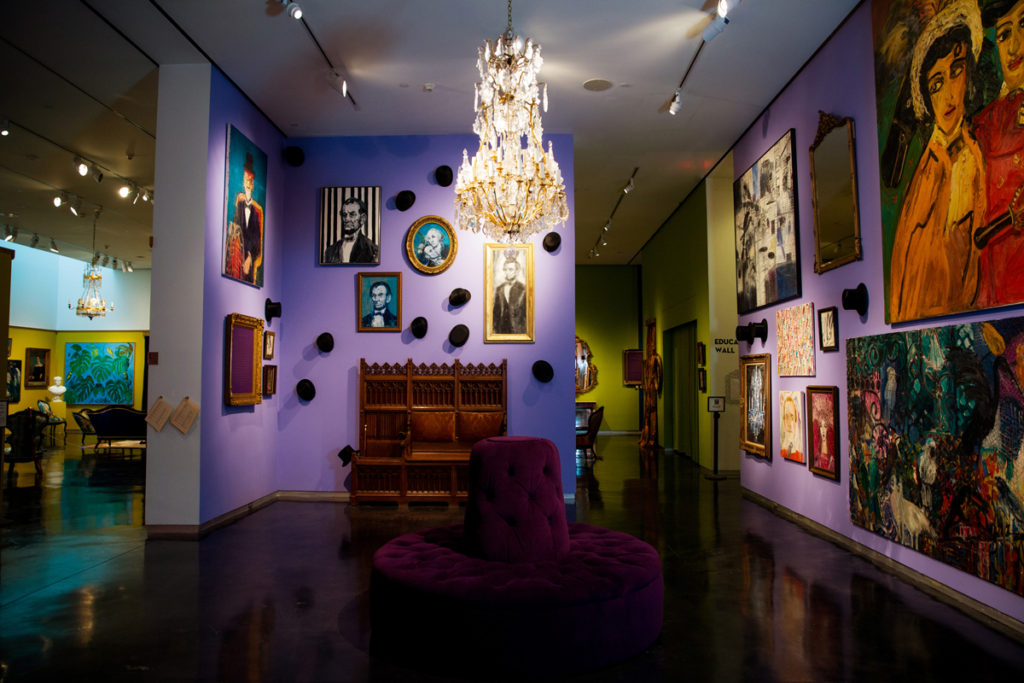 The exhibition space was made to reflect the design and character of Slonem's own homes, with details such as antique chandeliers and pieces from his top hat collection.