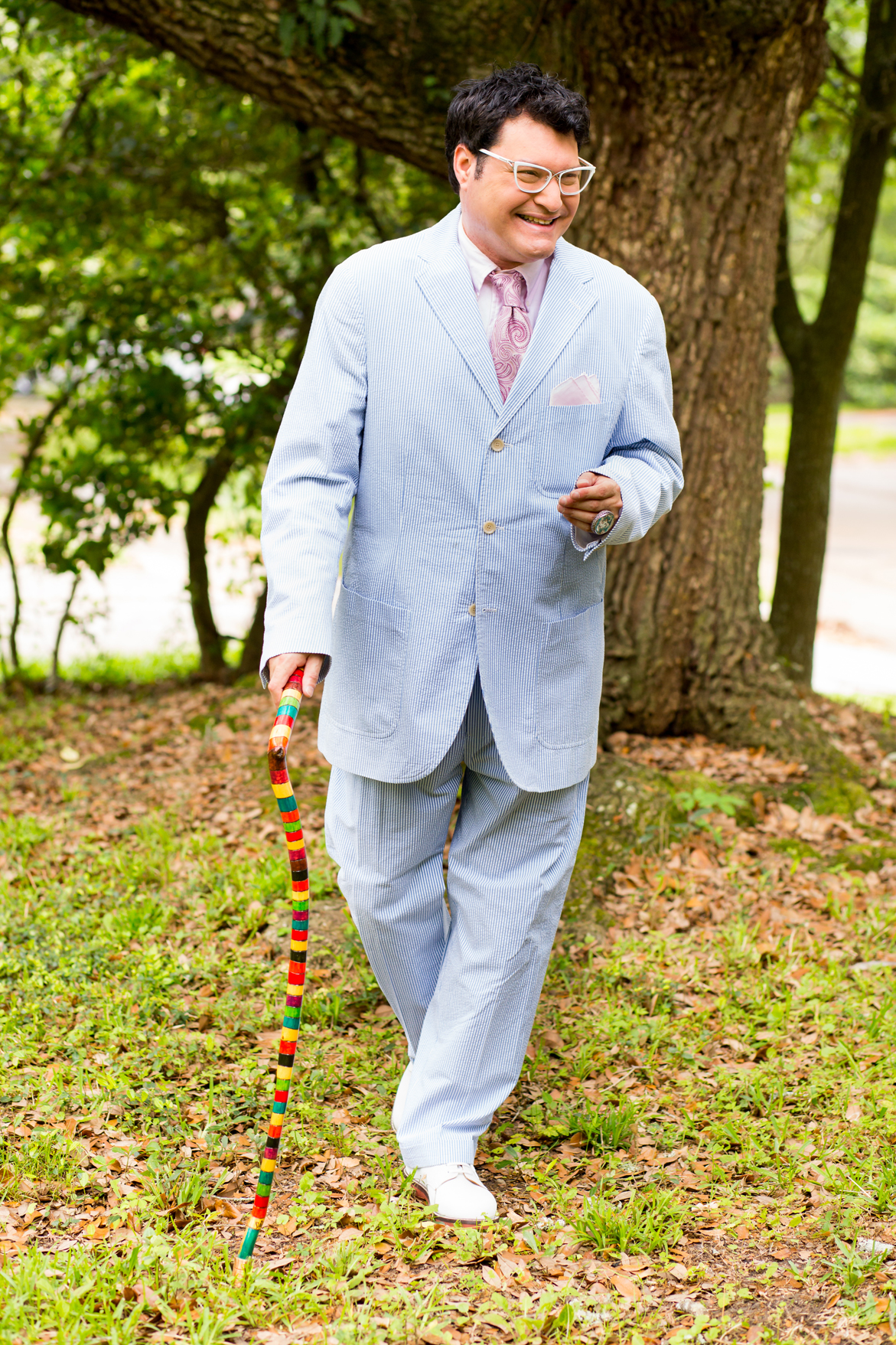 Polo by Ralph Lauren seersucker suit, Michael Kors tie, loafers from Carriage's Fine Clothiers, China Baroque ring and handmade cane by local artist Dab II