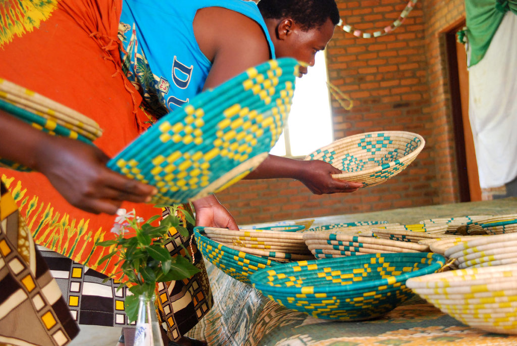 Last month, Hands Producing Hope launched its brightly colored basket collection made by the Rwandan women pictured here. Photo courtesy Hands Producing Hope