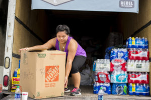 Lynnvi Dang loads a truck of donations at the event.