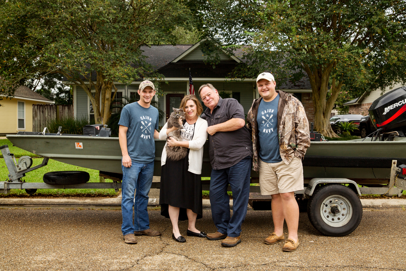 Marc Curry, Connie McLeod, Fancy Nancy, Steve Davison and Garrett Tillman rode this boat away from McLeod's home in the Millerville Road area, one of the hardest-hit parts of Baton Rouge. Photo by David Morris.