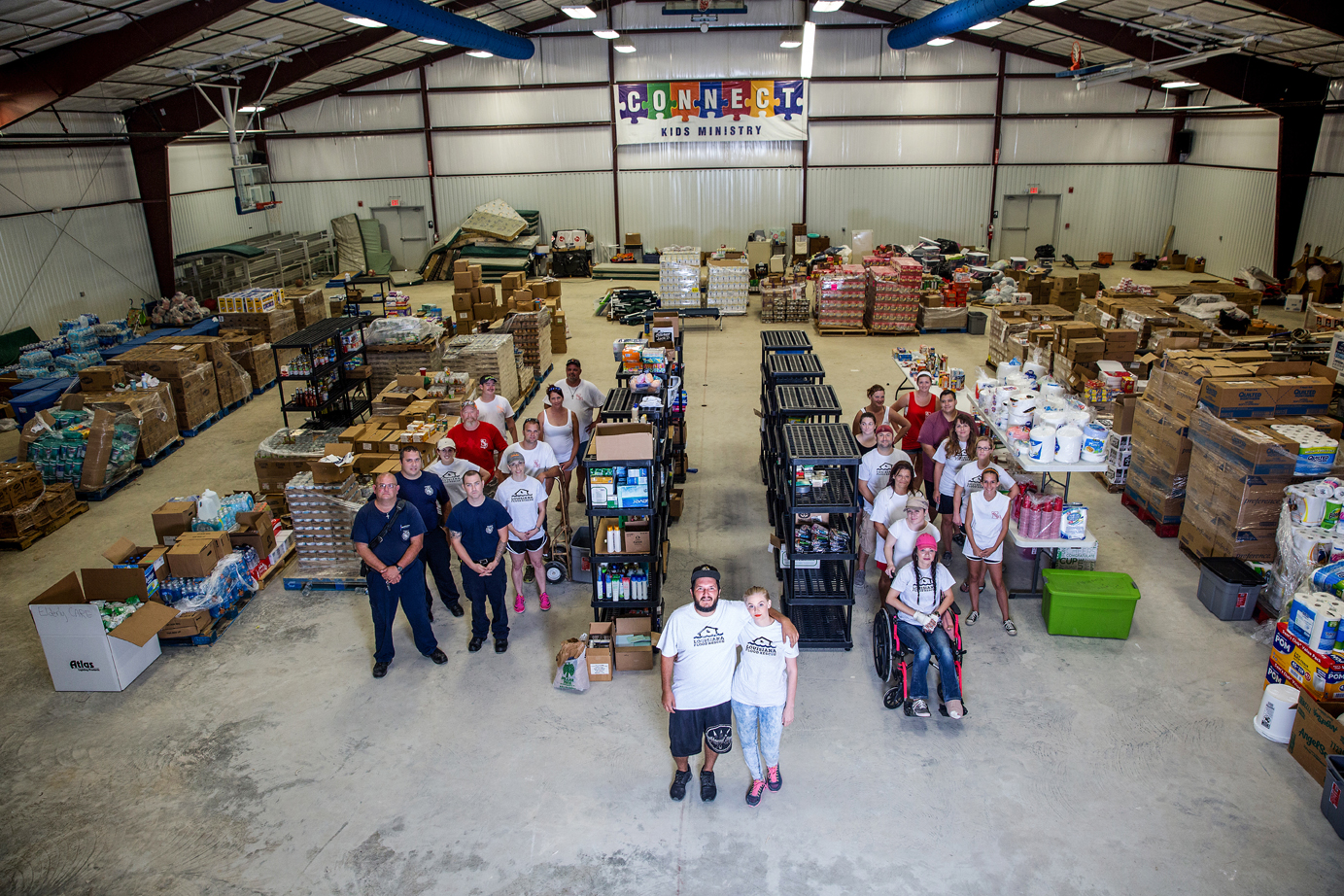 Louisiana Flood Rescue volunteers inside their new donation center at Life Tabernacle Church in Baker. Photo by Collin Richie.