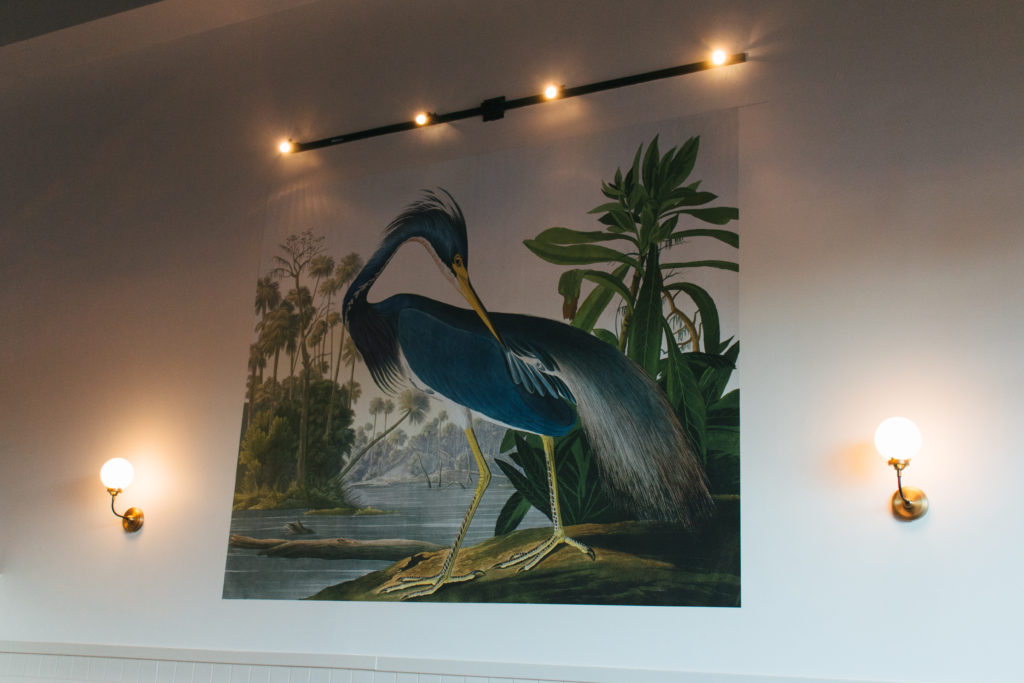 An 8-foot-wide mural of a Louisiana Blue Heron adorns one wall in the restaurant.