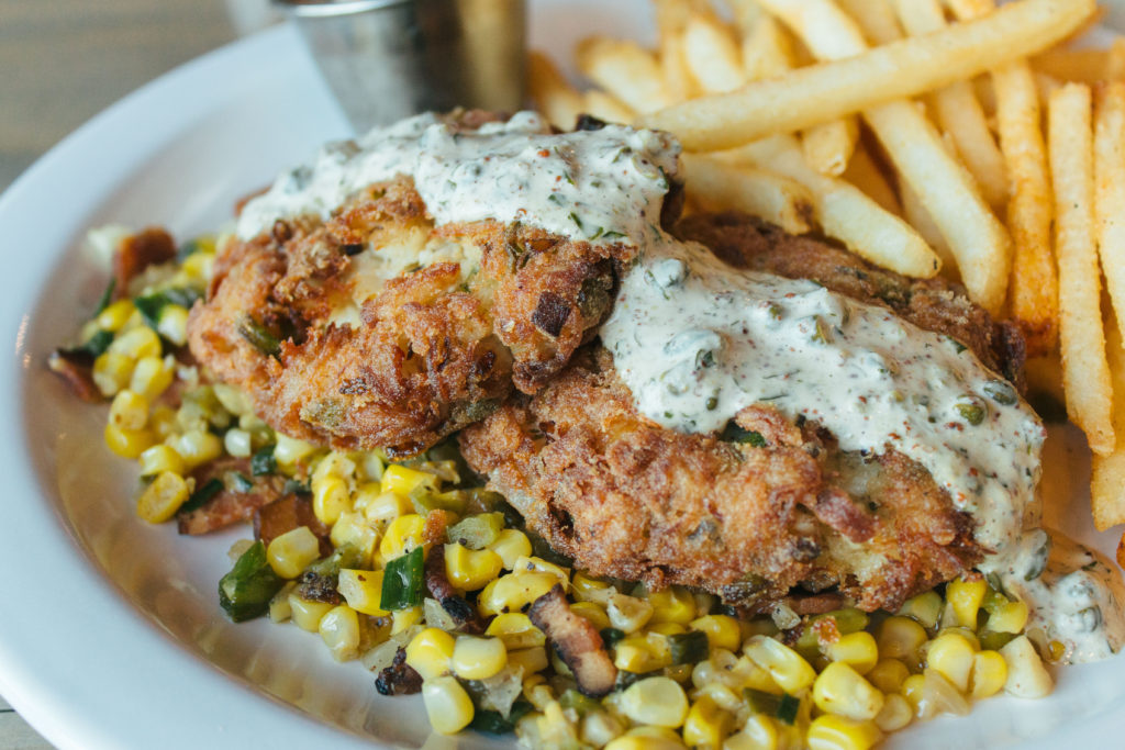 Crabcakes with ravigote sauce, corn maque choux and shoestring fries