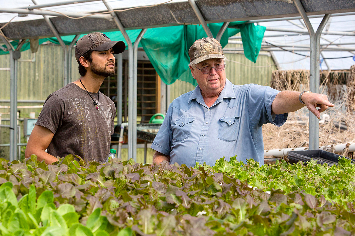 "Indie Plate's Paritosh ""Peru"" Sharma (left) visits with a local farmer. Photo by Michael Buck / Courtesy Indie Plate."