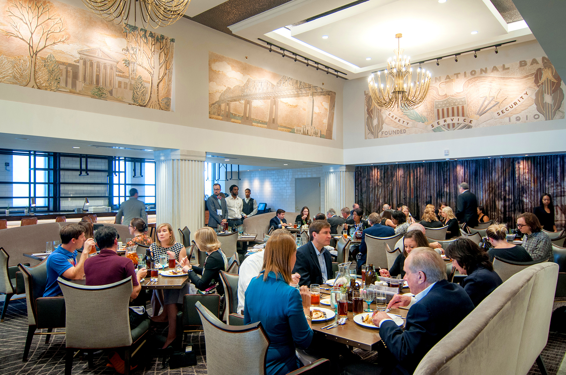 At the Watermark's lobby and restaurant, restored murals by iconic artist Angela Gregory offer diners a glimpse of local history. COURTESY WAMPOLD HOSPITALITY COLLECTION.