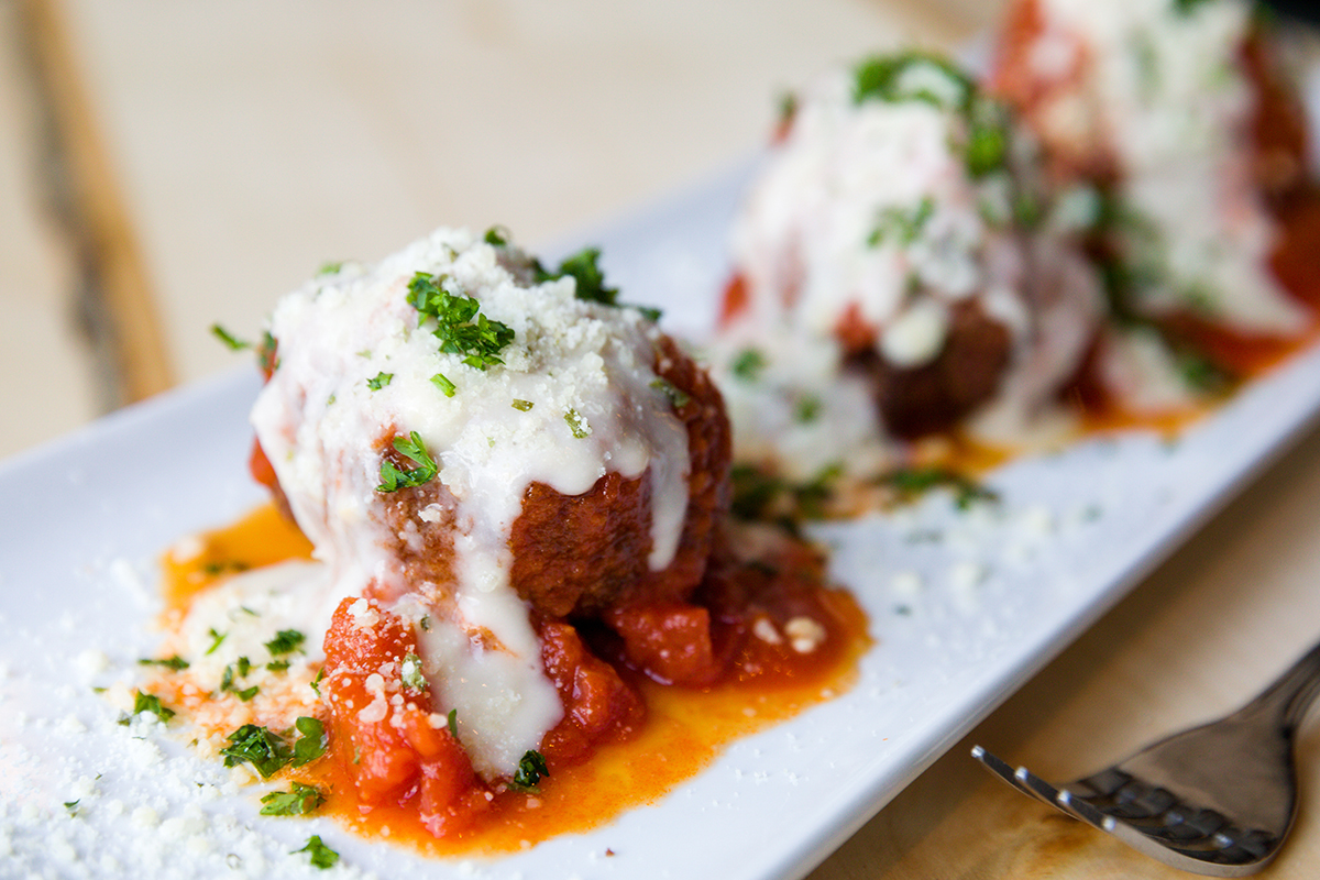 Closeup of the Crawfish Meatball. A satisfying starter that marries crawfish and crabmeat with an Italian-style red sauce.