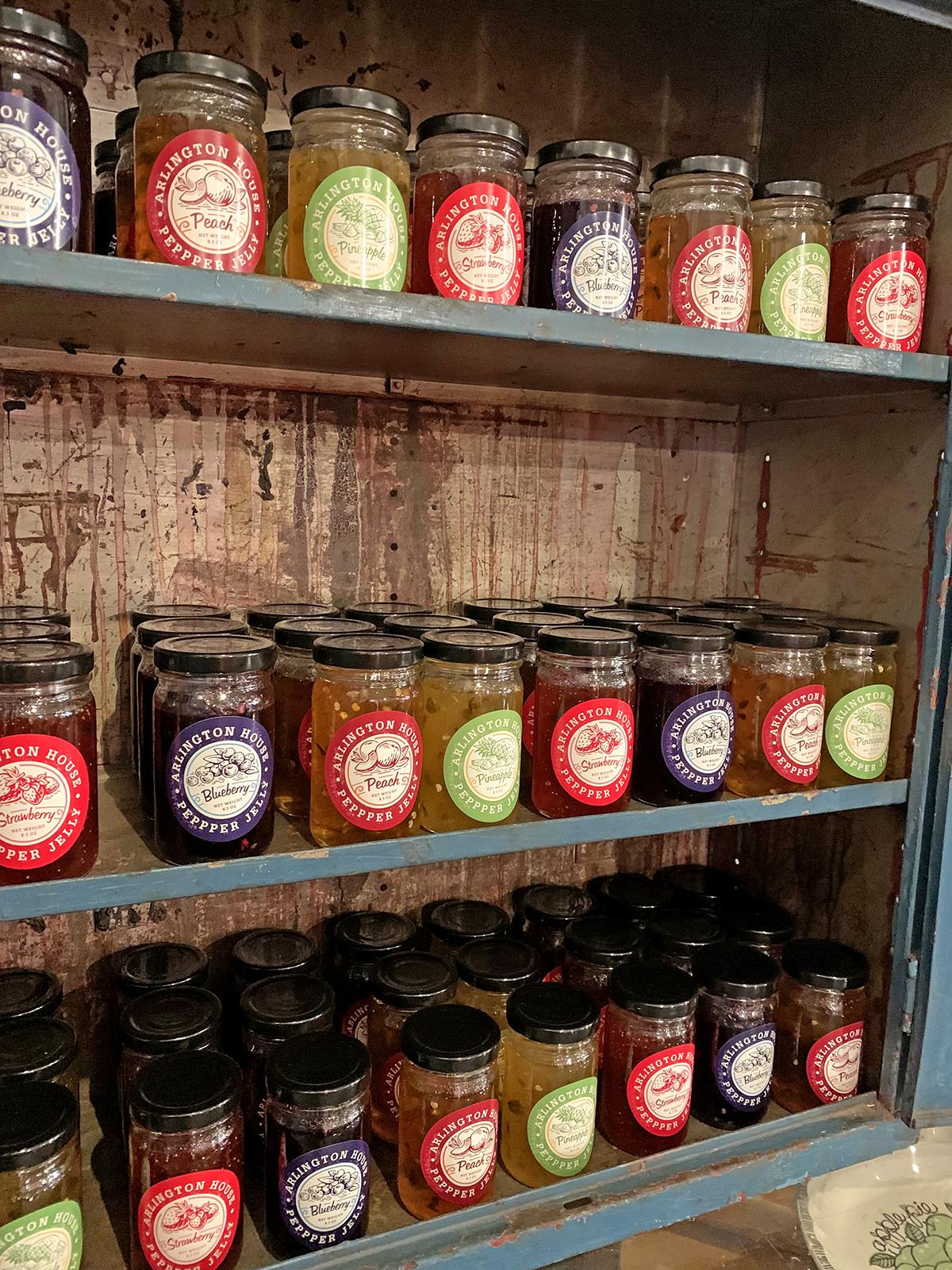 shelf full of pepper jelly jars