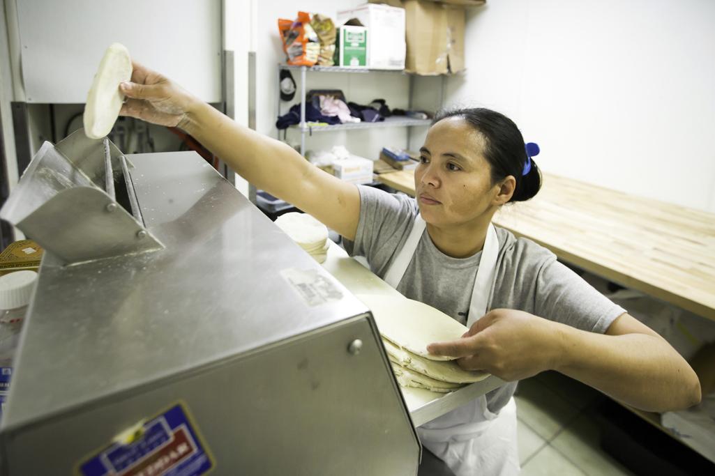 kolache kitchen manager heidi dunn arranges a dozen bacon and cheese