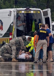 A rescue is made during unprecedented flooding in Louisiana. (THE ASSOCIATED PRESS)