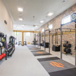 The 6,300-square-foot space includes a Functional Fitness room with an Olympic lifting area.