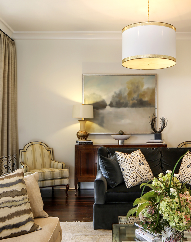 Elegant lighting sets the scene in the living room, from a large custom  drum pendant from Abat Jour to lamps by Michael Clement of New Orleans.