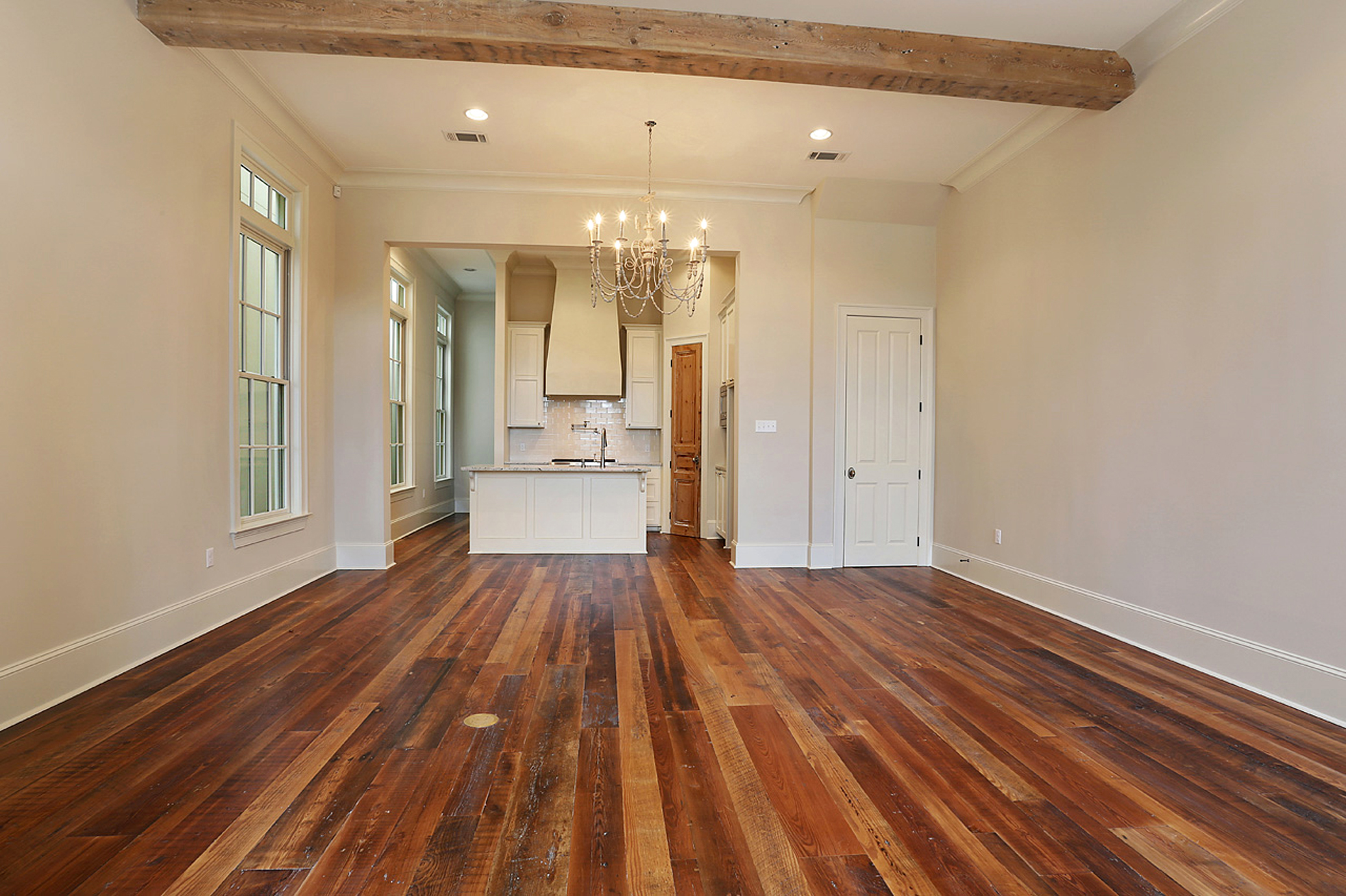 For this home in the Perkins Lane development, Holliday let features like old beams and heart-pine floors shine by keeping her palette toned down but textural.