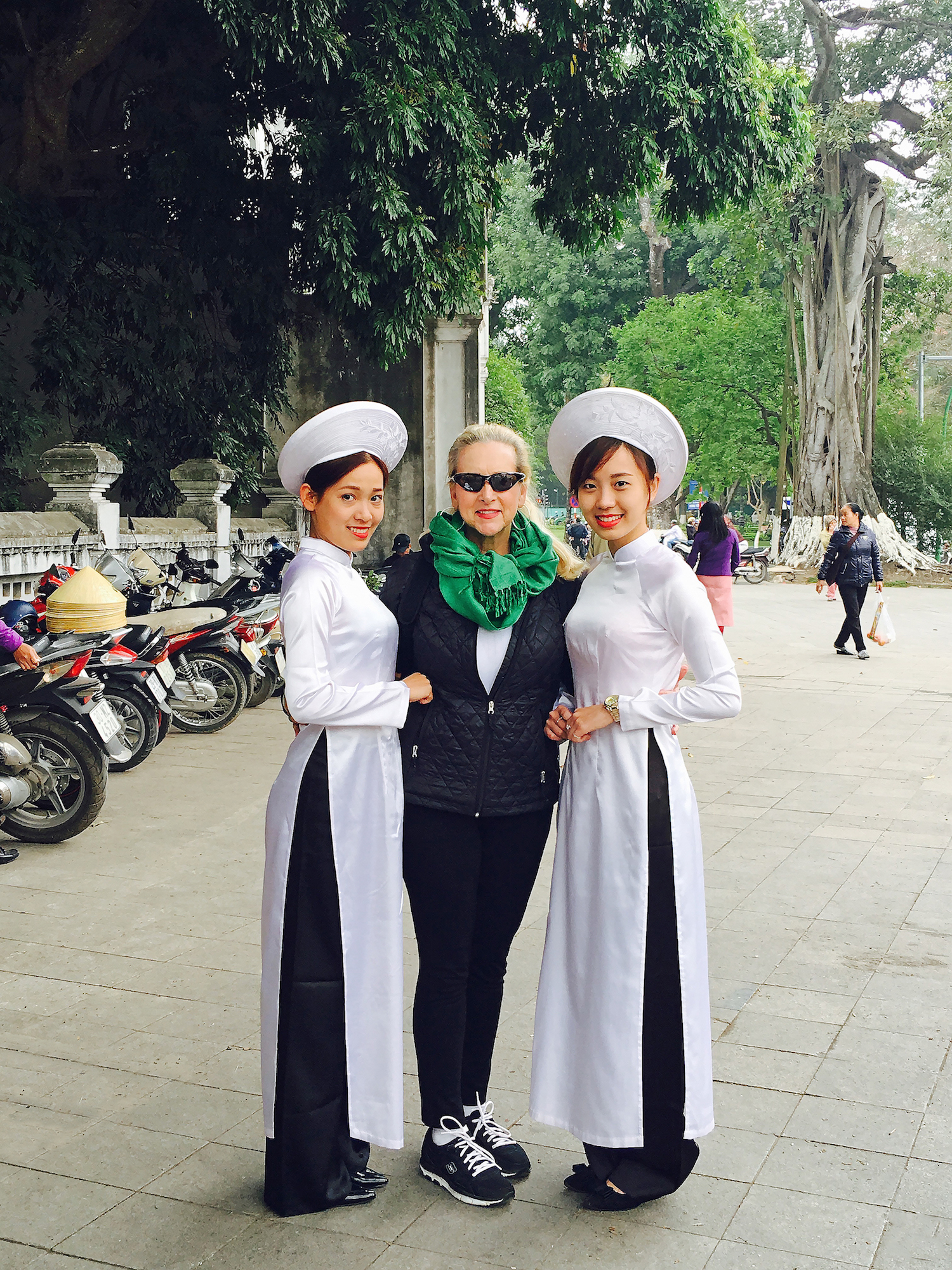 Astrid Clements with two Hanoi tour guides dressed in the traditional Vietnamese áo dài.