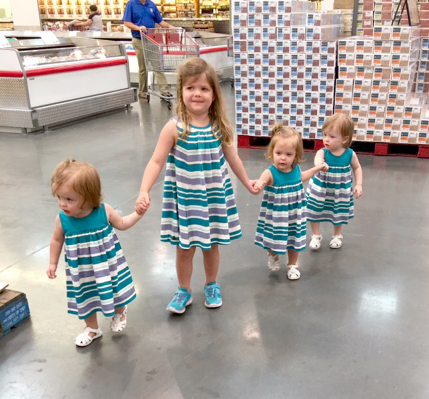 Grocery shopping without kids is a complete luxury, and not always possible in the Roussel household. Here Emily helps keep the triplets in check.
