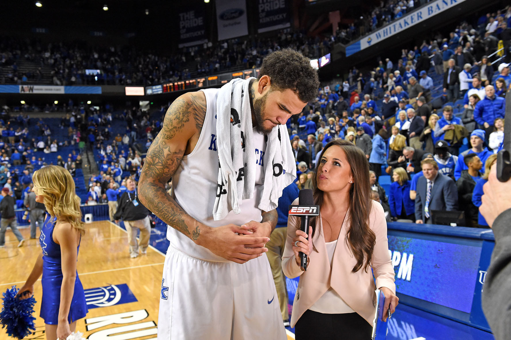 In addition to football, Hartung also reports on basketball and baseball for ESPN. Here, she interviews Willie Cauley-Stein of the Kentucky Wildcats. Photo by Scott Clarke / ESPN Images.