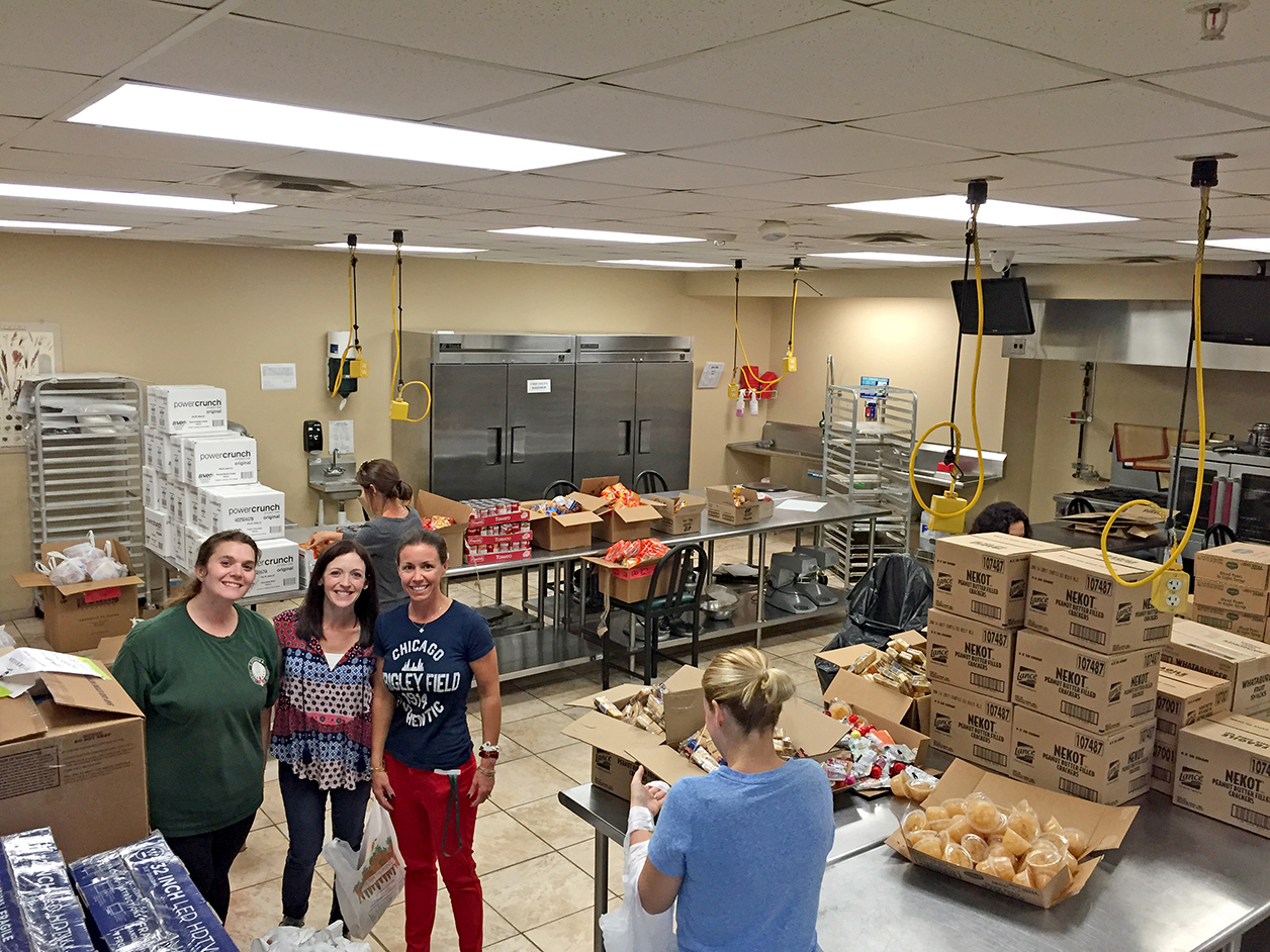 Louisiana Culinary Institute became the staging place to create Full Tummy Bags for Livingston Parish school children in need. Photo by Jeannie Frey Rhodes.