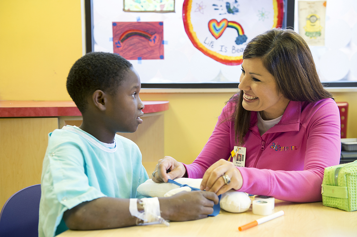 "Child Life specialists at OLOL work with children to help them understand what will happen during their stay, and to comfort them in times of duress. ""We help them understand why they are in the hospital, and that reduces their anxiety,"" says Sharon Wesberry, manager of the Child Life program. ""There can be so many intense moments for them."""