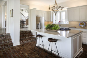 Kitchen to Bath Concepts designer Michelle Livings helped the Ponsons make over their kitchen, a project that included installing a new island and replacing black granite countertops with Taj Mahal quartzite from Michael Paul's Natural Stone.